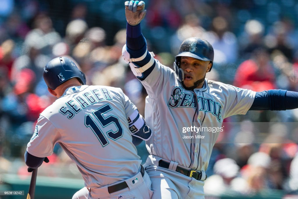 Kyle Seager #15 celebrates with Robinson Cano #22 of the Seattle Mariners after Cano hitt a two run home run during the second inning against the Cleveland Indians at Progressive Field on April 29, 2018 in Cleveland, Ohio.
