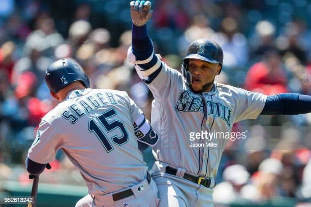 Kyle Seager celebrates with Robinson Cano of the Seattle Mariners after Cano hitt a two run home run during the second inning against the Cleveland...