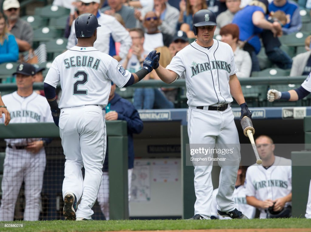 Kyle Seager #15 of the Seattle Mariners congratulates Jean Segura #2 after Segura scored a run on a single by Nelson Cruz #23 off starting pitcher Mark Leiter Jr. #59 of the Philadelphia Phillies during the first inning of an interleague game at Safeco Field on June 28, 2017 in Seattle, Washington. The Phillies won 5-4.