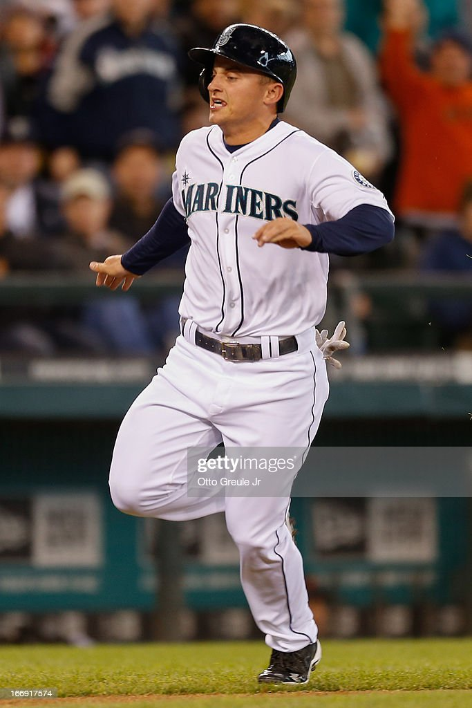 Kyle Seager #15 of the Seattle Mariners heads home to score on an RBI single by Endy Chavez against the Detroit Tigers in the seventh inning at Safeco Field on April 18, 2013 in Seattle, Washington. The Mariners defeated the Tigers 2-0.