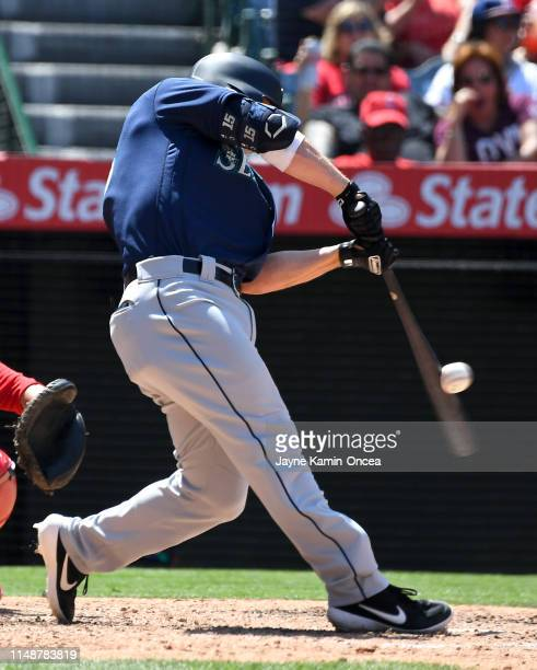 Kyle Seager of the Seattle Mariners hits a RBI single in the sixth inning of the game against the Los Angeles Angels at Angel Stadium of Anaheim on...