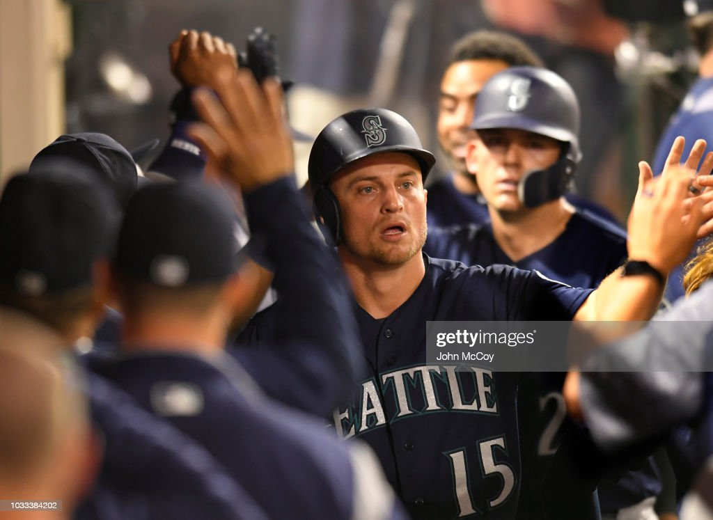 Kyle Seager #15 of the Seattle Mariners is congratulated after he scored on a two RBI Single by Dee Gordon #9 of the Seattle Mariners in the seventh inning against the Los Angeles Angels of Anaheim at Angel Stadium on September 14, 2018 in Anaheim, California.