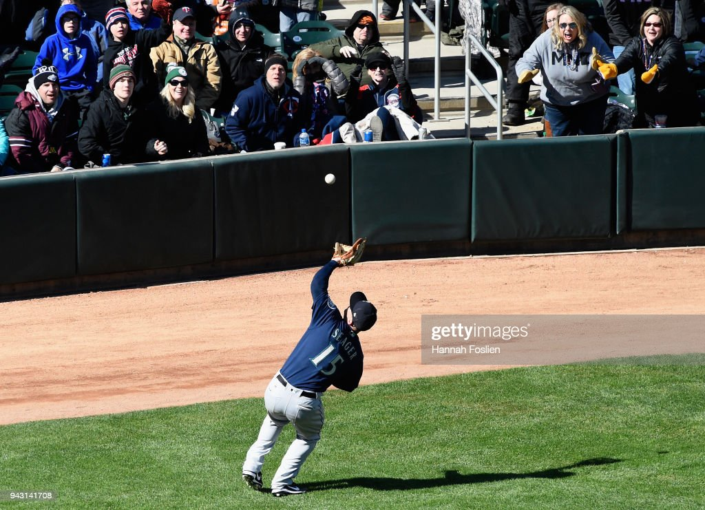 Kyle Seager #15 of the Seattle Mariners makes a catch in foul territory on the ball hit by Logan Morrison #99 of the Minnesota Twins during the seventh inning of the game on April 7, 2018 at Target Field in Minneapolis, Minnesota. The Mariners defeated the Twins 11-4.
