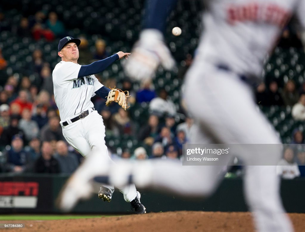 Kyle Seager #15 of the Seattle Mariners makes the out at first against Alex Bregman #2 of the Houston Astros in the fifth inning at Safeco Field on April 16, 2018 in Seattle, Washington. The Seattle Mariners beat the Houston Astros 2-1.