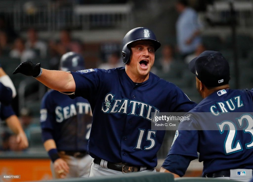 Kyle Seager #15 of the Seattle Mariners reacts with Nelson Cruz #23 after hitting a three-run homer in the eighth inning to score Taylor Motter #21 and Danny Valencia #26 against the Atlanta Braves at SunTrust Park on August 23, 2017 in Atlanta, Georgia.