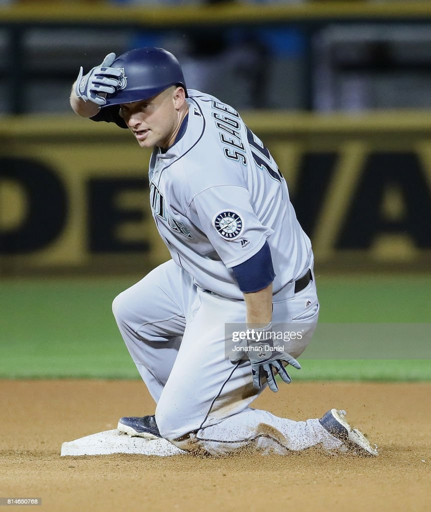 Kyle Seager #15 of the Seattle Mariners slides into second base with a double in the 6th inning against the Chicago White Sox at Guaranteed Rate Field on July 14, 2017 in Chicago, Illinois.
