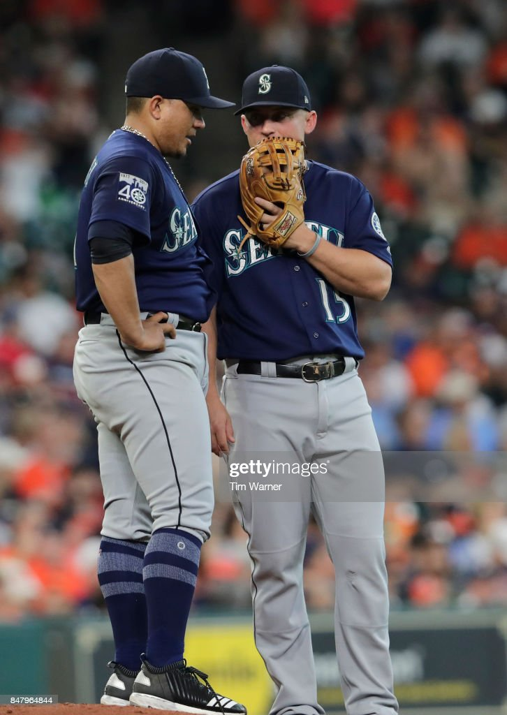 Kyle Seager #15 of the Seattle Mariners talks with Erasmo Ramirez #31 in the second inning against the Houston Astros at Minute Maid Park on September 16, 2017 in Houston, Texas.