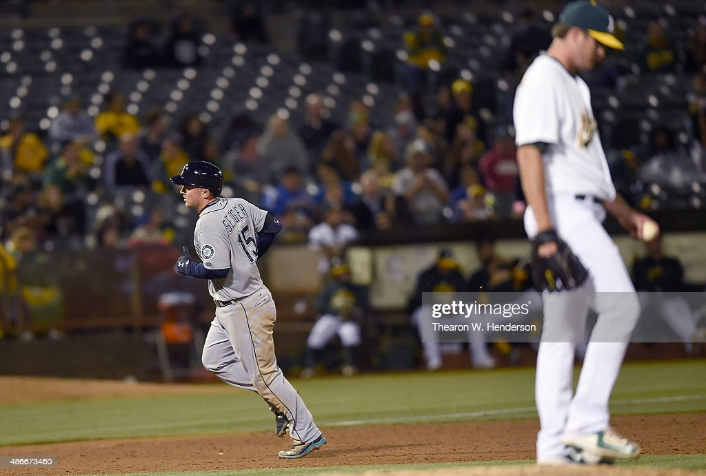 Kyle Seager #15 of the Seattle Mariners trots around the bases after hitting a two-run homer off of Drew Pomeranz #13 of the Oakland Athletics in the top of the ninth inning at O.co Coliseum on September 4, 2015 in Oakland, California. The Mariners won the game 11-8.