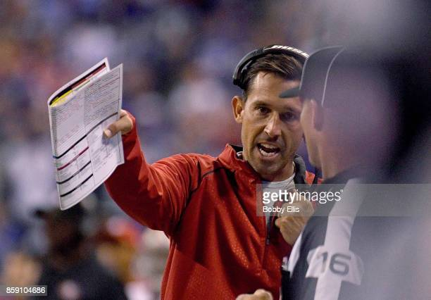 Kyle Shanahan head coach of the San Francisco 49ers talks to a referee during overtime during the game between the Indianapolis Colts and the San...