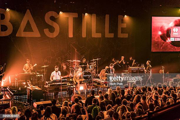 Kyle Simmons Chris Wood Dan Smith and Will Farquarson of Bastille perform on stage at iHeartRadio Theater on September 6 2016 in Burbank California