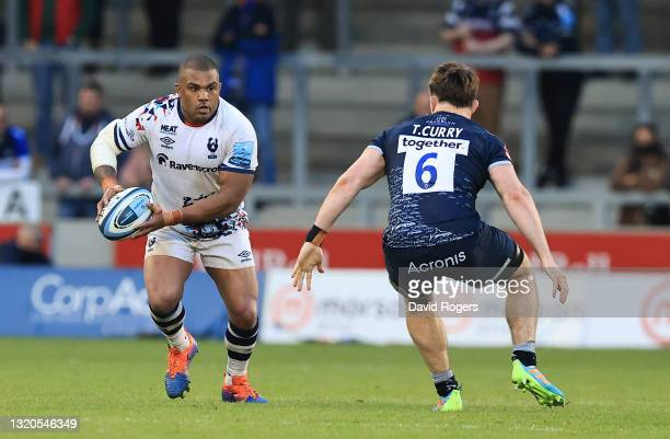 Kyle Sinckler of Bristol Bears takes on Tom Curry during the Gallagher Premiership Rugby match between Sale Sharks and Bristol Bears at AJ Bell...