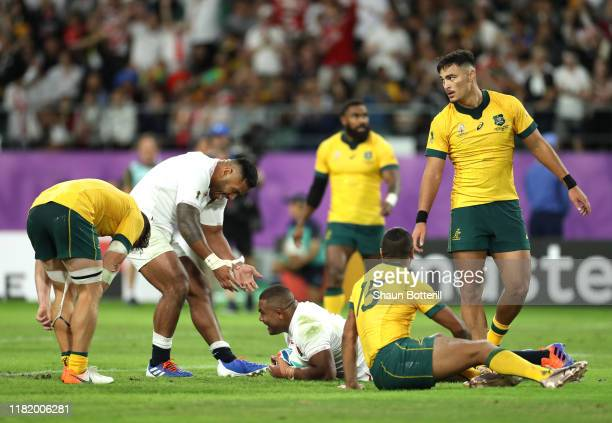 Kyle Sinckler of England celebrates with Manu Tuilagi as he scores his team's third try during the Rugby World Cup 2019 Quarter Final match between...