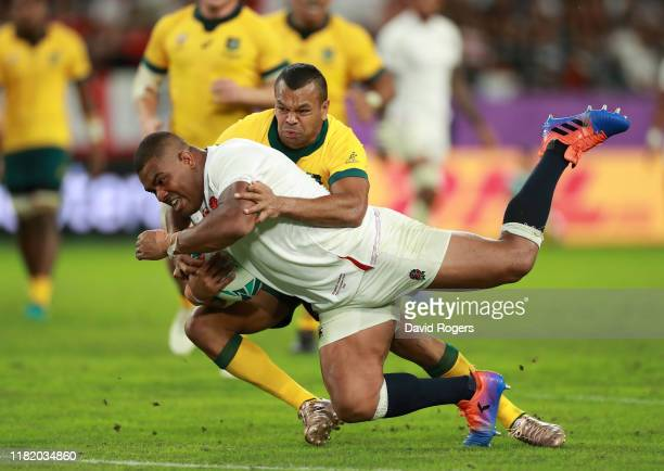 Kyle Sinckler of England dives over for their third try despite being held by Kurtley Beale during the Rugby World Cup 2019 Quarter Final match...