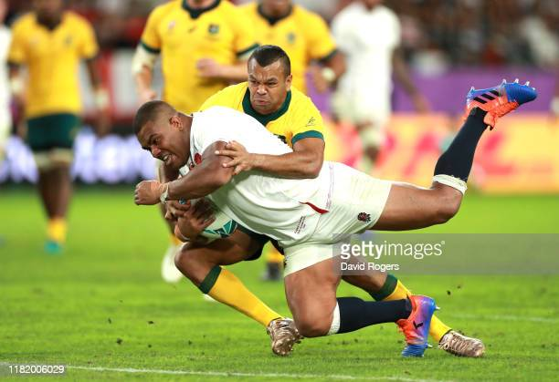 Kyle Sinckler of England holds off Kurtley Beale of Australia as he touches down to score his team's third try during the Rugby World Cup 2019...