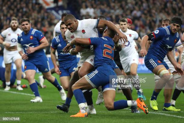 Kyle Sinckler of England is tackled by Baptiste Couilloud of France during the NatWest Six Nations match between France and England at Stade de...