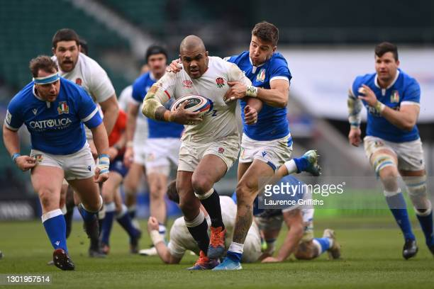 Kyle Sinckler of England is tackled by Luca Sperandio of Italy during the Guinness Six Nations match between England and Italy at Twickenham Stadium...