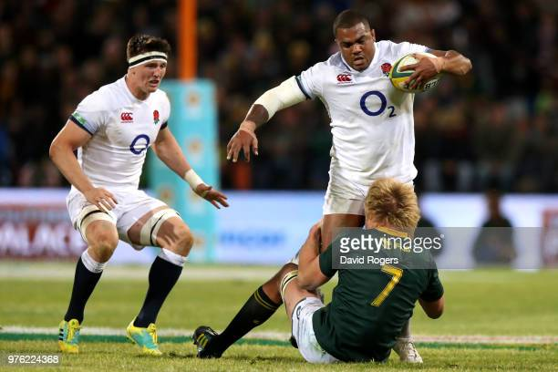 Kyle Sinckler of England is tackled by South Africa's PieterSteph du Toit during the second test match between South Africa and England on June 16...