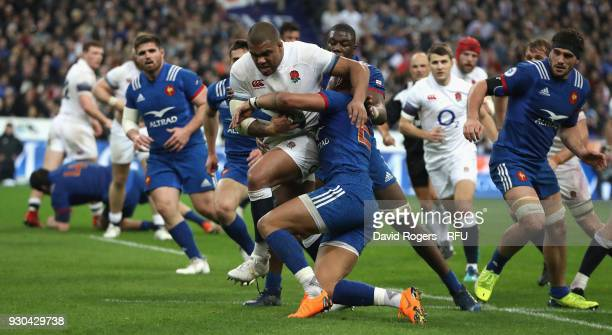 Kyle Sinckler of England is tackled during the NatWest Six Nations match between France and England at Stade de France on March 10 2018 in Paris...