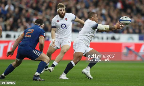Kyle Sinckler of England off loads the ball during the NatWest Six Nations match between France and England at Stade de France on March 10 2018 in...