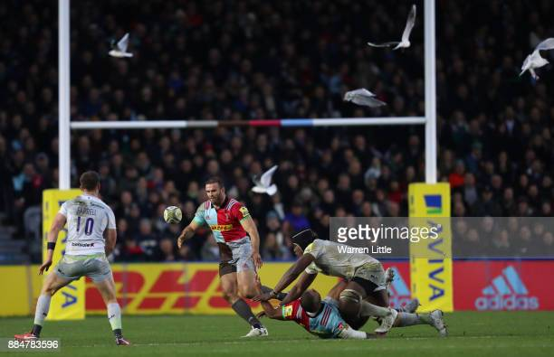 Kyle Sinckler of Halequins is tackled by Maro Itoje of Saracens during the Aviva Premiership match between Harlequins and Saracens at Twickenham...