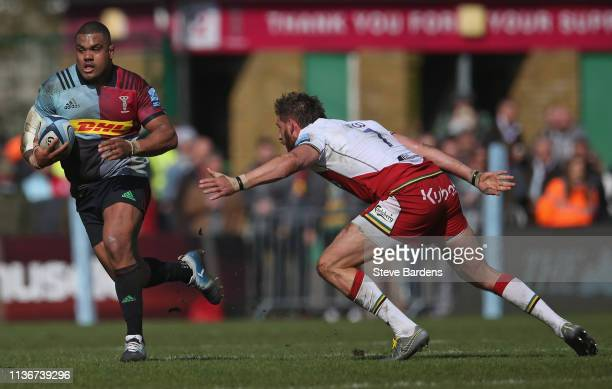 Kyle Sinckler of Harlequins breaks away from Tom Wood of Northampton Saints during the Gallagher Premiership Rugby match between Harlequins and...