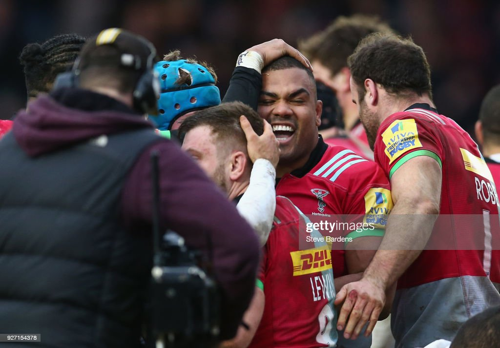 Kyle Sinckler of Harlequins (2nd R) celebrates scoring a try with his team mates during the Aviva Premiership match between Harlequins and Bath Rugby at Twickenham Stoop on March 4, 2018 in London, England.