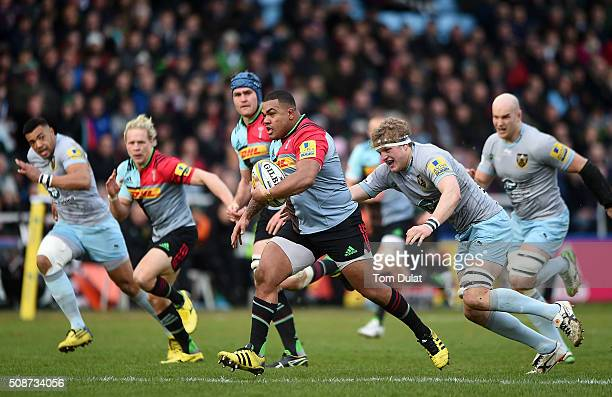 Kyle Sinckler of Harlequins is tackled by Jamie Gibson of Northampton Saints during the Aviva Premiership match between Harlequins and Northampton...