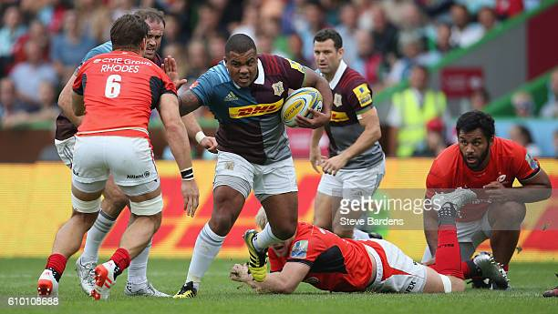 Kyle Sinckler of Harlequins is tackled by Michael Rhodes of Saracens during the Aviva Premiership match between Harlequins and Saracens at Twickenham...