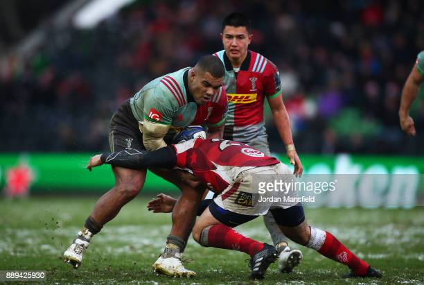 Kyle Sinckler of Harlequins is tackled by Rob Herring of Ulster during the European Rugby Champions Cup match between Harlequins and Ulster Rugby at...