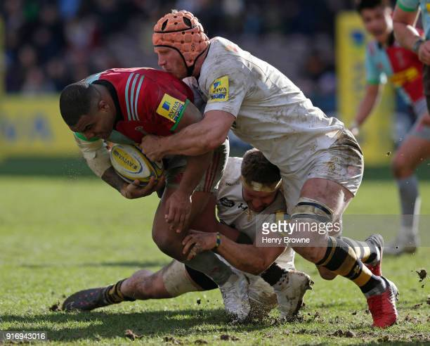 Kyle Sinckler of Harlequins tackled by Kearnan Myall and Thomas Young of Wasps during the Aviva Premiership match between Harlequins and Wasps at...