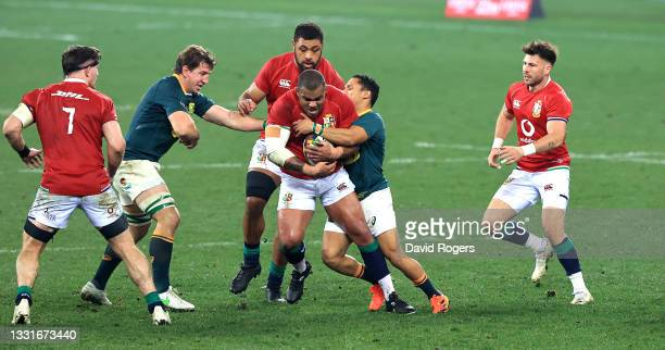 Kyle Sinckler of the Lions is tackled during the 2nd test match between South Africa Springboks and the British & Irish Lions at Cape Town Stadium on...