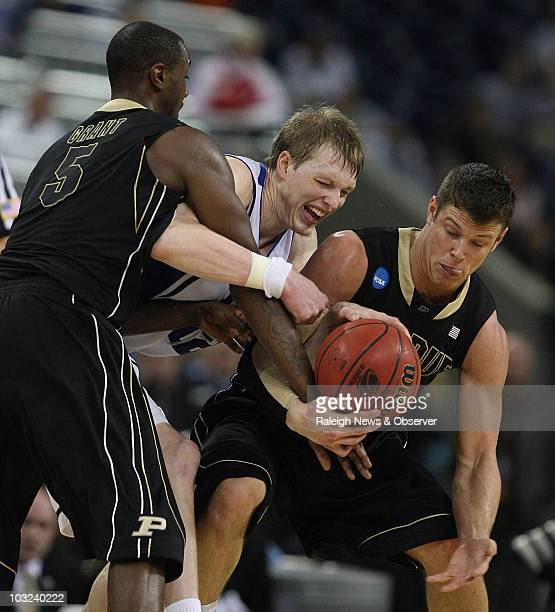 Kyle Singler of Duke center battles the defense of Keaton Grant and Chris Kramer of Purdue in the second half at the NCAA South Regional on Friday...