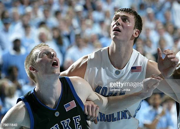 Kyle Singler of the Duke Blue Devils battles for a rebound on a free throw with Tyler Hansbrough of the North Carolina Tar Heels during their game at...