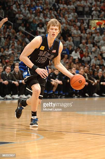 Kyle Singler of the Duke Blue Devils dribbles the ball during a college basketball game against the Georgetown Hoyas on January 30, 2010 at the...