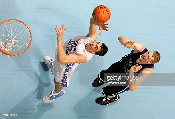 Kyle Singler of the Duke Blue Devils jumps for a rebound with Tyler Hansbrough of the North Carolina Tar Heels during their game at the Dean E Smith...
