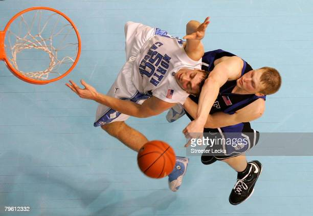 Kyle Singler of the Duke Blue Devils knocks into Tyler Hansbrough of the North Carolina Tar Heels during their game at the Dean E Smith Center on...