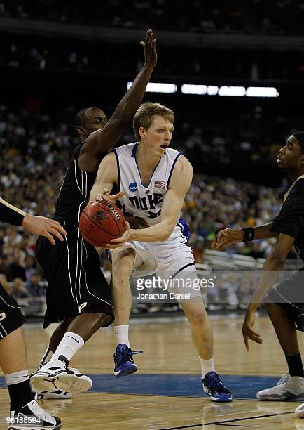 Kyle Singler of the Duke Blue Devils looks to pass under pressure from Keaton Grant of the Purdue Boilermakers during the south regional semifinal of...