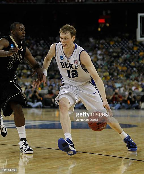 Kyle Singler of the Duke Blue Devils moves against Keaton Grant of the Purdue Boilermakers during the south regional semifinal of the 2010 NCAA men's...