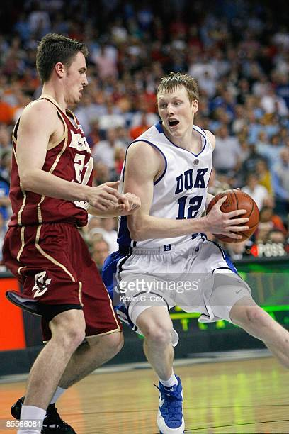Kyle Singler of the Duke Blue Devils moves the ball against Tyler Roche of the Boston College Eagles during day two of the 2009 ACC Men's Basketball...