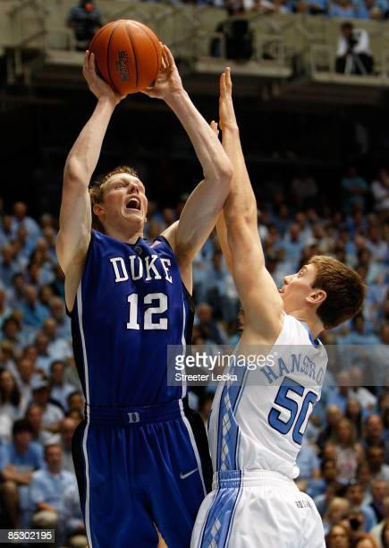 Kyle Singler of the Duke Blue Devils shoots the ball over Tyler Hansbrough of the North Carolina Tar Heels during their game at the Dean E. Smith...