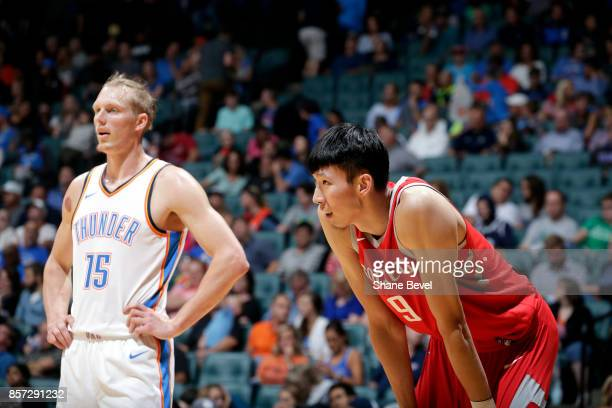 Kyle Singler of the Oklahoma City Thunder and Zhou Qi of the Houston Rockets react to a play during the preseason game on October 3 2017 at the BOK...