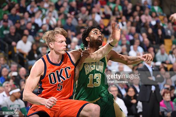Kyle Singler of the Oklahoma City Thunder boxes out against James Young of the Boston Celtics on March 16 2016 at the TD Garden in Boston...