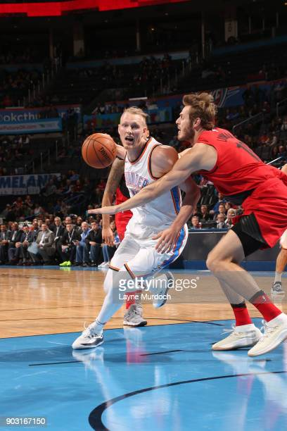 Kyle Singler of the Oklahoma City Thunder handles the ball against the Portland Trail Blazers on January 9 2018 at Chesapeake Energy Arena in...