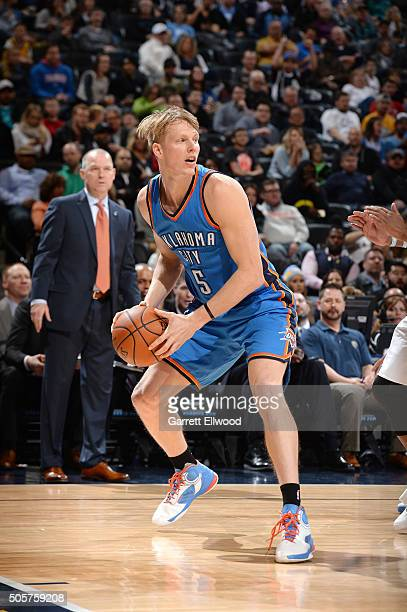 Kyle Singler of the Oklahoma City Thunder handles the ball during the game against the Denver Nuggets on January 19 2016 at the Pepsi Center in...