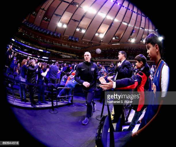 Kyle Singler of the Oklahoma City Thunder high fives fans before the game against the New York Knicks on December 16 2017 at Madison Square Garden in...