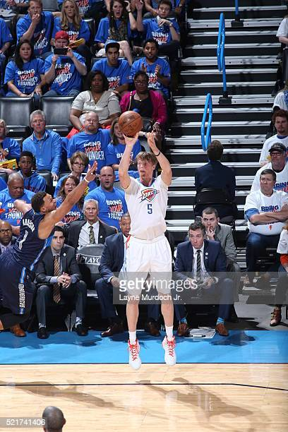 Kyle Singler of the Oklahoma City Thunder shoots against Justin Anderson of the Dallas Mavericks in Game One of the Western Conference Quarterfinals...