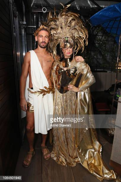 Kyle Smith dressed as Greek God and Fashion designer Christian Siriano dressed as Everything at The Misshapes Halloween party hosted by Ketel One...