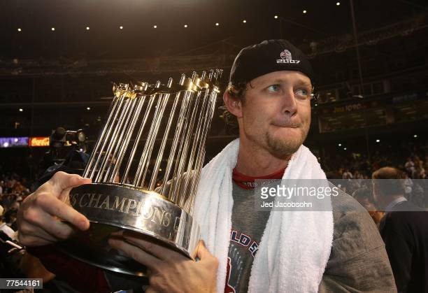 Kyle Snyder of the Boston Red Sox celebrates with the trophy after winning Game Four by a score of 43 to win the 2007 Major League Baseball World...