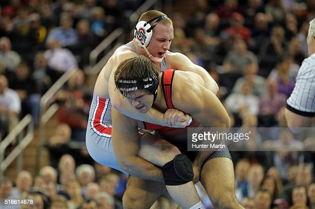Kyle Snyder of the Ohio State Buckeyes wrestles Nick Gwiazdowski of the North Carolina State Wolfpack during the finals of the NCAA Wrestling...