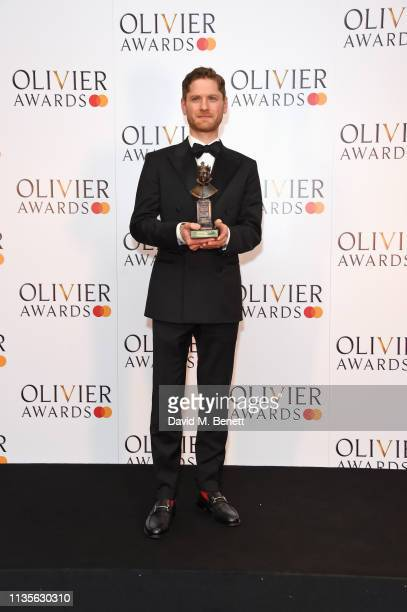 Kyle Soller winner of the Best Actor award for The Inheritance poses in the press room at The Olivier Awards 2019 with Mastercard at The Royal Albert...